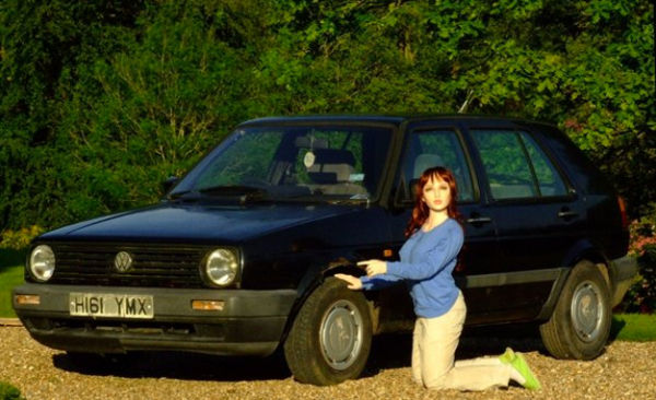 Lars and the Real Golf: Guy Advertises Used VW Using Creepy Doll as Model